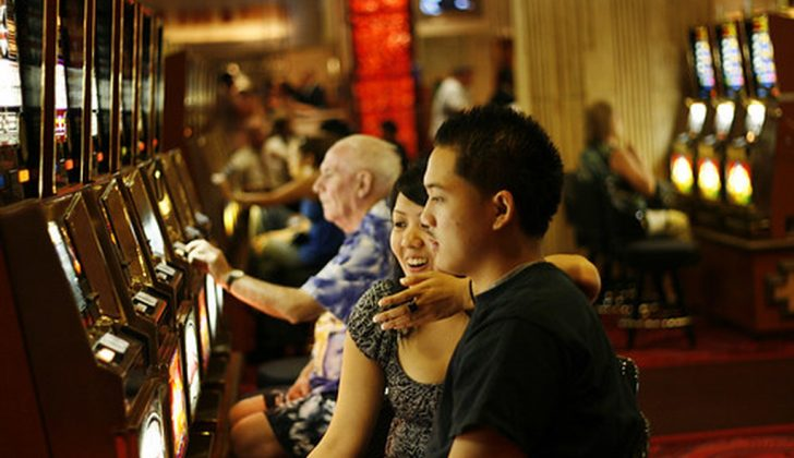 couple playing slots