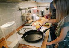 child cooking frying pan