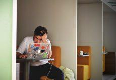 stressed man using computer