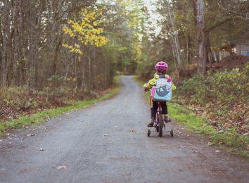 child on little bike