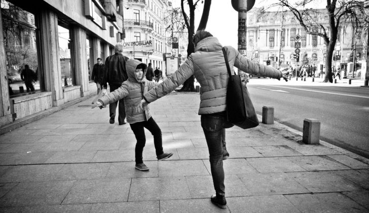 mother twirling with son