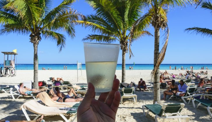 drinking on beach in mexico