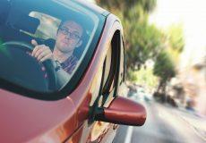 man driving down the street
