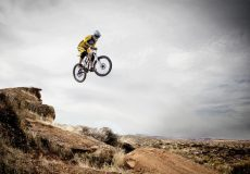 mountain biker jumping over rocks