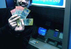 man holding cash smiling