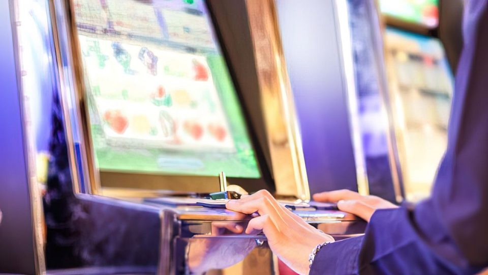 person playing on arcade machine
