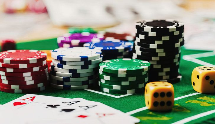 poker chips stacked near cards