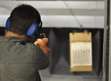 man shooting handgun